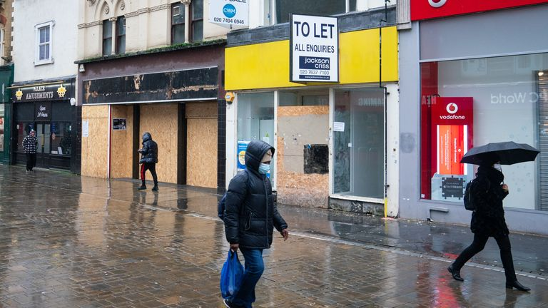 People pass empty shop units in Croydon, during England's third national lockdown to curb the spread of coronavirus. Picture date: Tuesday February 16, 2021