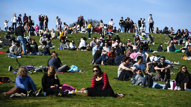Crowds enjoy the sun in London after lockdown eases to allow groups of six outside