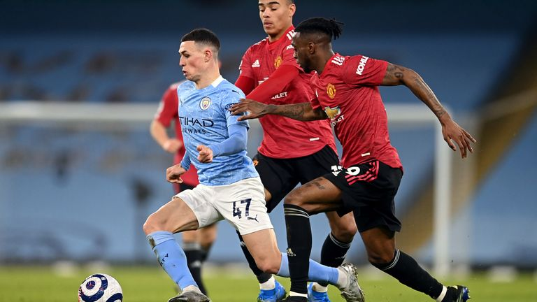 Manchester City's Phil Foden Manchester United's mason Greenwood and Aaron Wan-Bissaka (left-right) battle for the ball during the Premier League match at the Etihad Stadium, Manchester. Picture date: Sunday March 7, 2021.