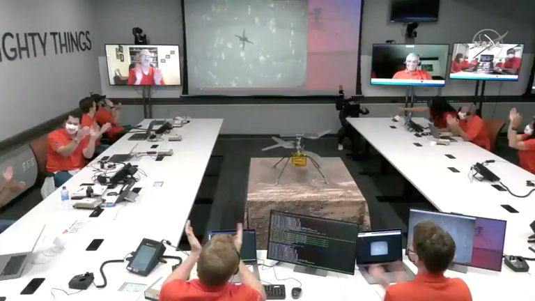 The team at NASA's Jet Propulsion Laboratory (JPL) react after the Mars helicopter Ingenuity's first flight