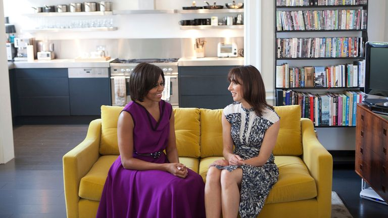 U.S. first lady Michelle Obama (L) and Samantha Cameron, wife of British Prime Minister David Cameron, talk before having tea in the private residence at Downing Street in London in this official White House handout photo taken on May 24, 2011and released by the White House on May 25, 2011. REUTERS/Lawrence Jackson/The White House/Handout (UNITED STATES - Tags: POLITICS)