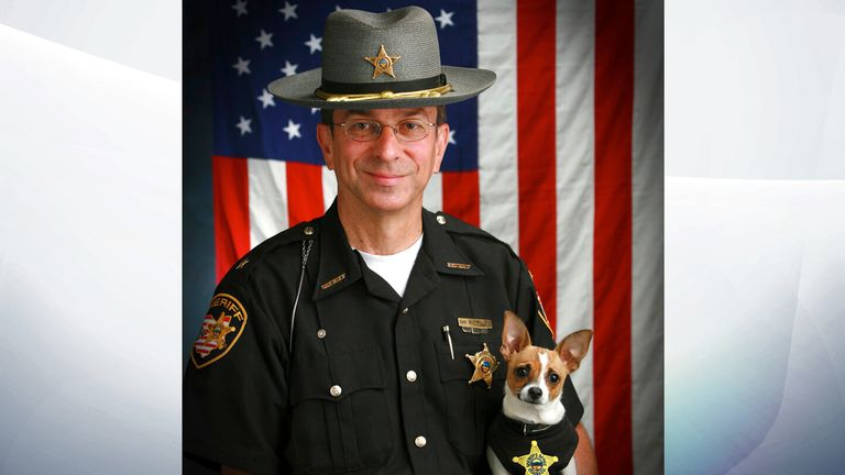 Midge was certified the smallest police dog in the world. Pic: John Hoffart/AP