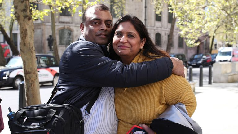 Seema Misra, who was jailed for a conviction of theft in 2010, celebrates with her husband Davinder