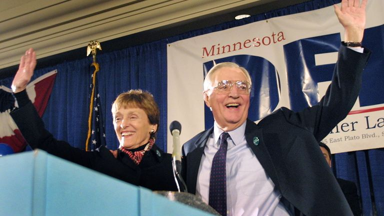 Democratic Senate candidate and former Vice President Walter Mondale and his wife Joan wave to supporters from the stage before election results were in at his election night headquarters in St.Paul, Minnesota, November 5, 2002. REUTERS/Scott Cohen/File Photo