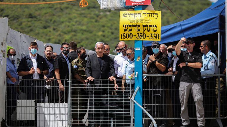Israeli Prime Minister Benjamin Netanyahu visits the scene of the tragedy. Pic: AP