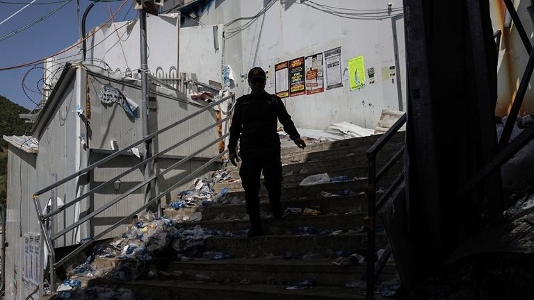 An Israeli security official at the site of the tragedy. Pic: AP