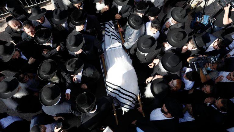 Mourners carry the body of Rabbi Eliezer Goldberg. Pic: AP
