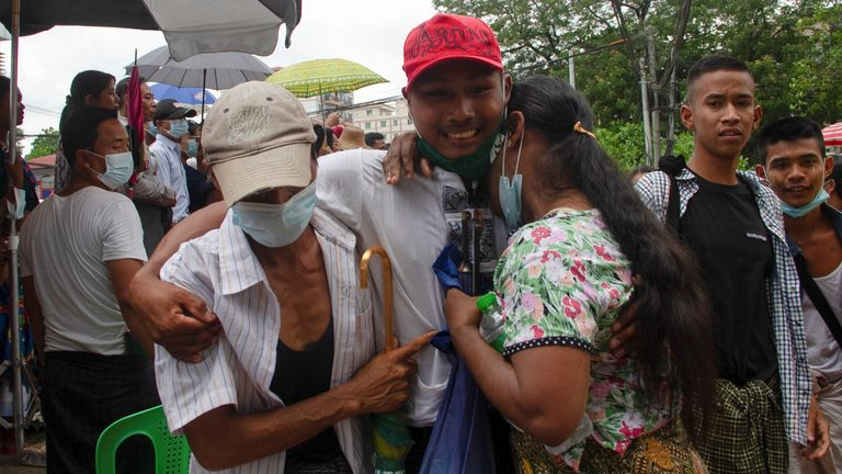 A released prisoner embraces his relatives outside the Insein prison