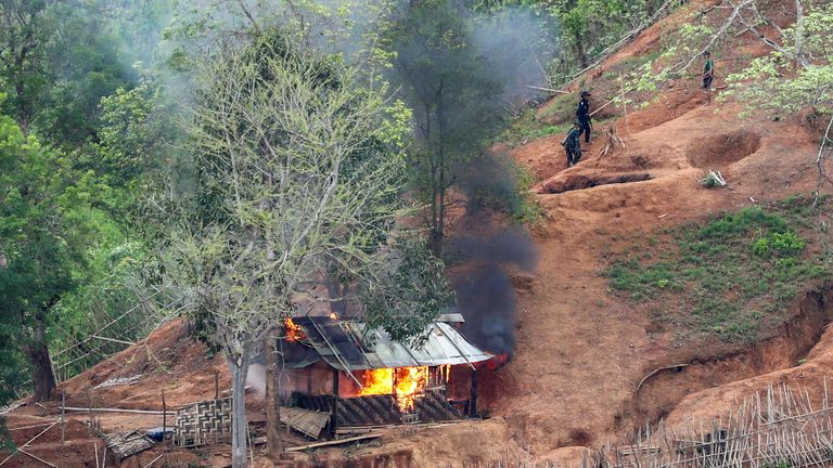 Karen troops set fire to a building inside a Myanmar army outpost close to the Thai border