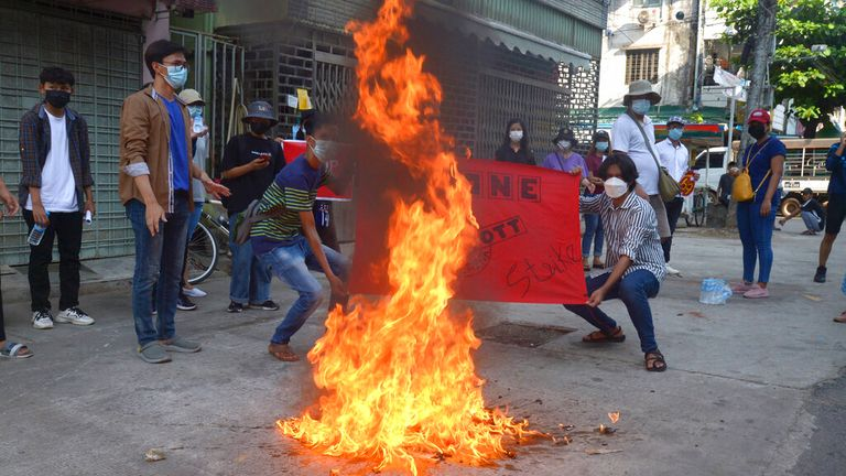 Anti-coup protesters burned a Chinese flag in Yangon on Wednesday. Pic: AP