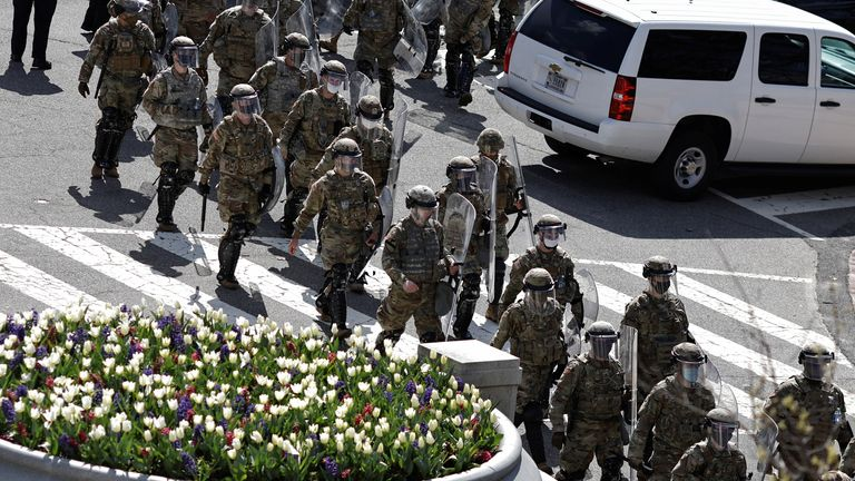 National Guard members patrol the streets surrounding the U.S. Capitol