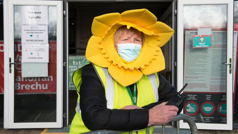 An official dressed as a daffodil outside the vaccination centre in The Royal Welsh Showground, Builth Wells, Wales
