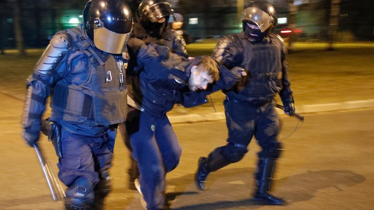 Police detain a man during a protest in support of Alexei Navalny in St Petersburg, Russia in April. Pic: AP
