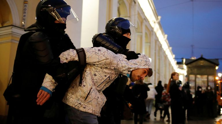 A demonstrator is taken away by law enforcement officers during a rally in support of jailed Russian opposition politician Alexei Navalny