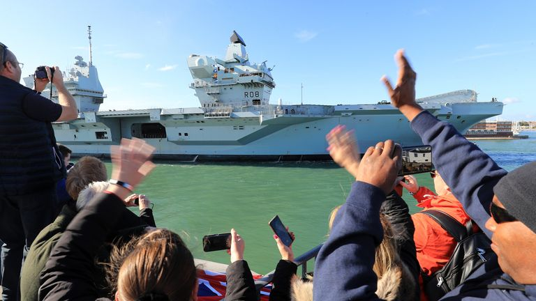The Royal Navy aircraft carrier HMS Queen Elizabeth arrives back in Portsmouth Naval Base