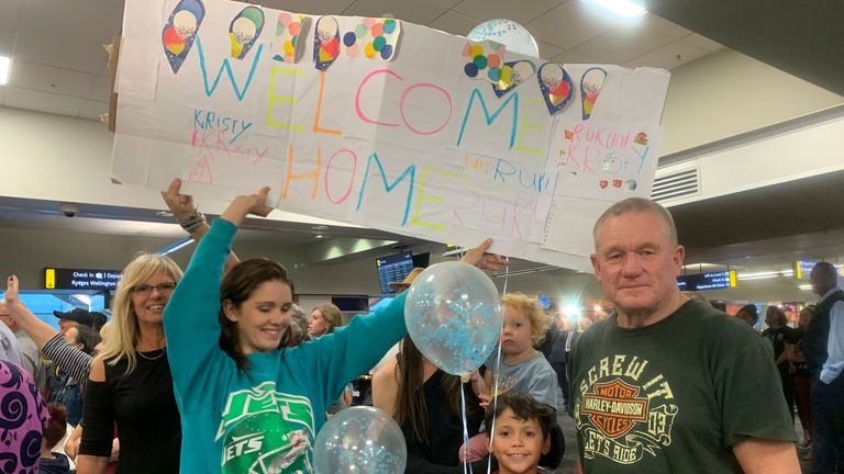 Danny Mather, right, and other family members wait at the Wellington International Airport for the arrival of Mather's pregnant daughter Kristy. Pic: AP