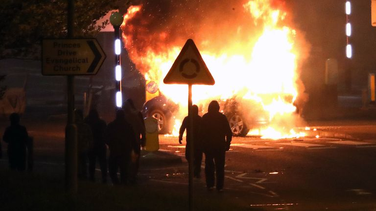 Masked loyalists after hijacking and setting a car on fire at the Cloughfern roundabout in Newtownabbey