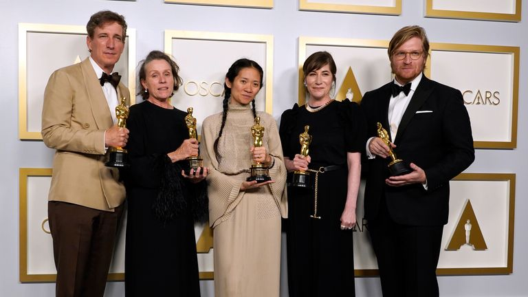 Nomadland producers Peter Spears, Frances McDormand, Chloe Zhao, Mollye Asher and Dan Janvey, winners of the Oscar for best picture. Pic: AP