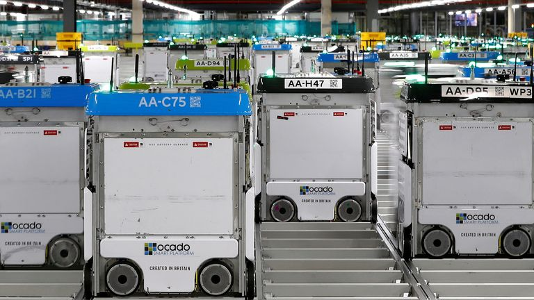 """""""Bots"""" are seen on the grid of the """"smart platform"""" at the Ocado CFC (Customer Fulfilment Centre) in Andover, Britain May 1, 2018."""