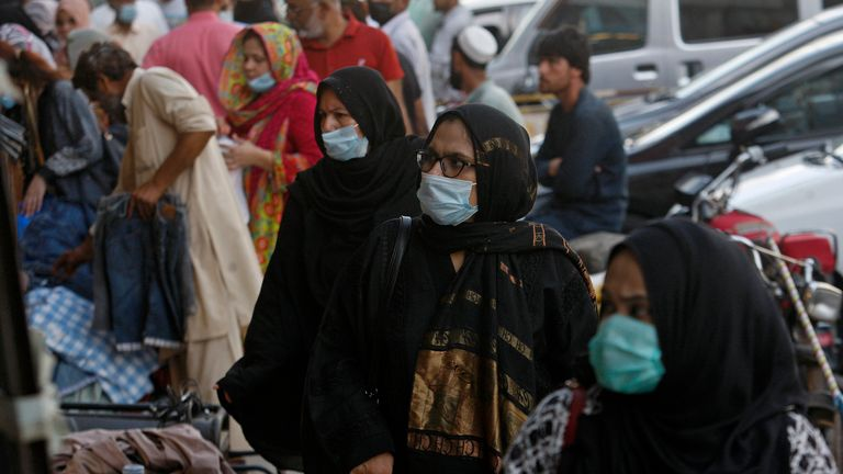 Women wearing face masks to prevent the spread of the disease, going to the market for shopping, in Karachi, Pakistan, Wednesday, April 28, 2021. (AP Photo / Fareed Khan)