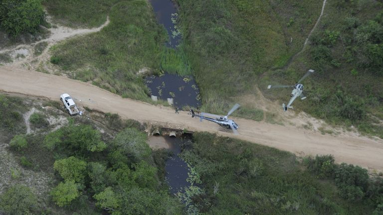 Helicopters search for survivors after the attack on the Amarula hotel