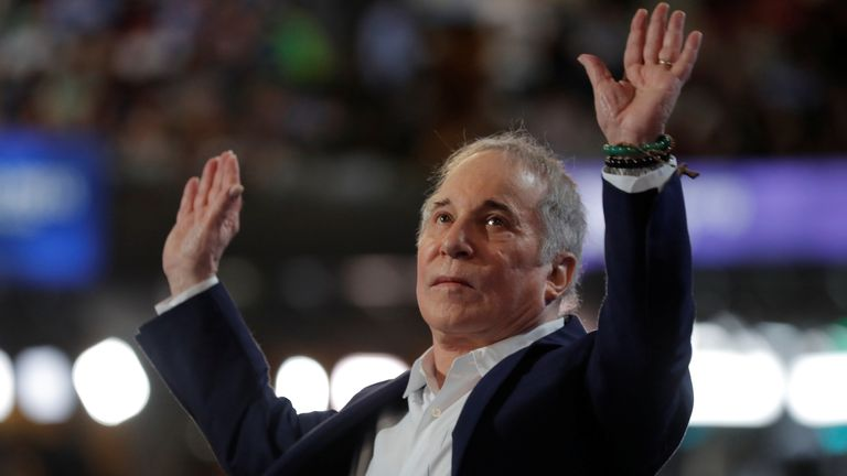 Singer Paul Simon greets the audience while performing at the Democratic National Convention in Philadelphia, Pennsylvania, U.S., July 25, 2016