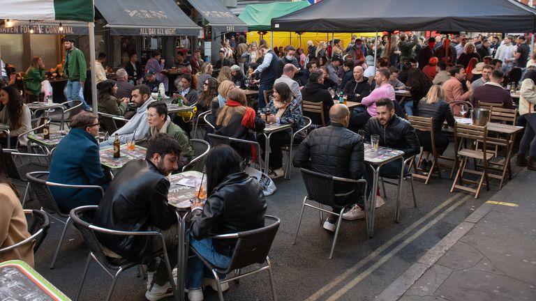People eat and drink in central London as COVID lockdown restrictions are eased