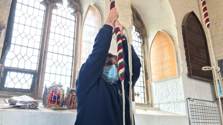 The ninth bell at Blackburn Cathedral is being tolled with a half muffle by Ray Hutchings of the Lancashire County Association of Change Ringers.