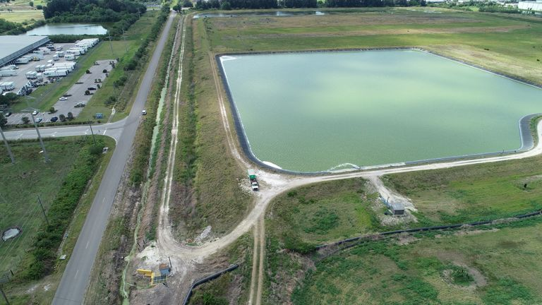 A reservoir of a defunct phosphate plant south of Tampa, where a leak at a waste water reservoir forced the evacuation of hundreds of homes and threatened to flood the area and Tampa Bay with polluted water, is seen in an aerial photograph taken in Piney Point, Florida, U.S. April 4, 2021.