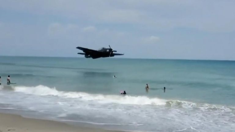 A pilot escaped serious injury after making a World War II-era airplane land safely close to shore on Satellite Beach, Florida.