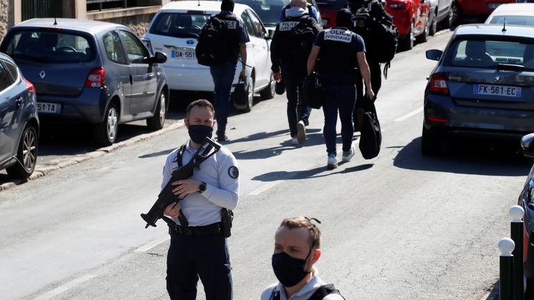 Police officers secure the area where an attacker stabbed a female police administrative worker, in Rambouillet, near Paris