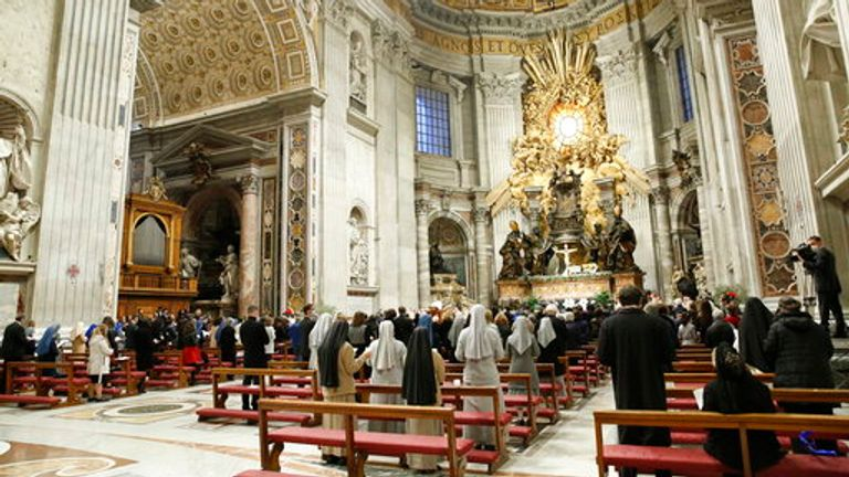 Pope Francis celebrates the Easter Vigil in a nearly empty St Peter's Basilica