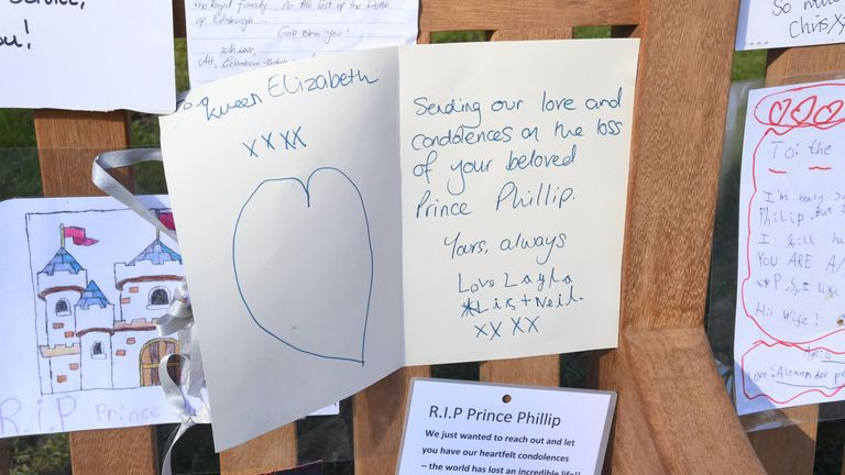 Some of the tributes left outside Buckingham Palace