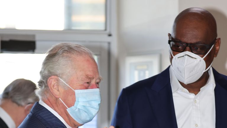 The Prince of Wales with Pastor Agu Irukwu (right) during a visit to the church's vaccine pop-up clinic