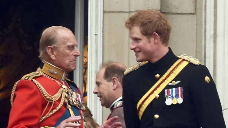 Prince Philip, Duke of Edinburgh, Prince Harry, Catherine, Duchess of Cambridge and Prince William, Duke of Cambridge stand on the balcony of Buckingham Palace following the Trooping the Colour ceremony in London on June 14, 2014.