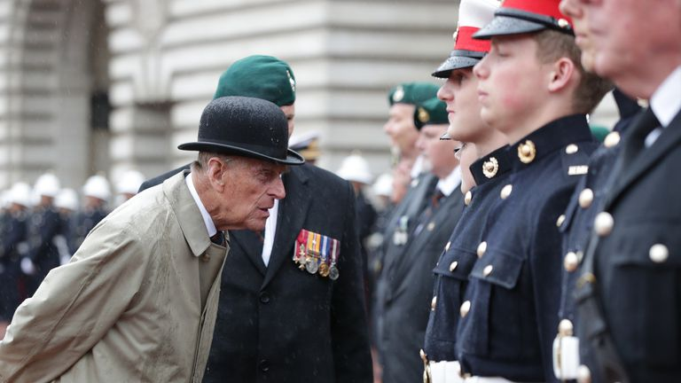 (170803) -- LONDON, Aug. 3, 2017 (Xinhua) -- Britain's Prince Philip(L), Duke of Edinburgh, reacts as he attends a parade in the role of Royal Marines' Captain General for the last time at Buckingham Palace in London, Britain on Aug. 2, 2017. Prince Philip, husband of Queen Elizabeth II, carries out his final solo public engagement Wednesday before he retires from royal duties. (Xinhua/Pool) -UK OUT-