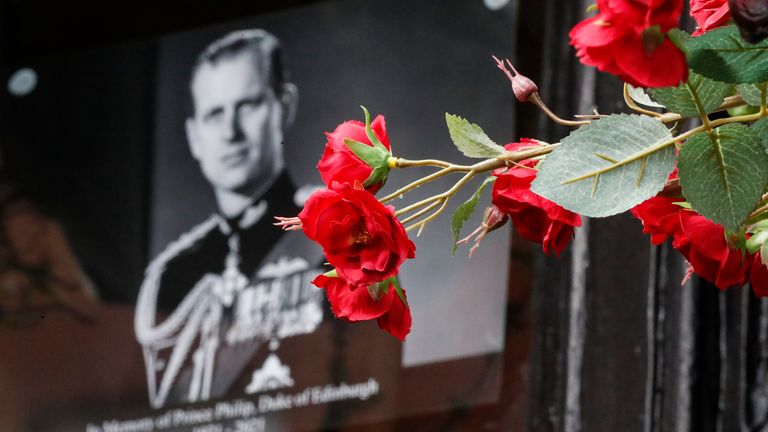 Flowers in front of a photograph of Britain's Prince Philip outside Windsor Castle