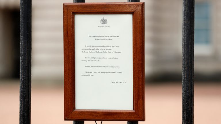 An announcement regarding the death of Britain's Prince Philip is displayed on the fence of Buckingham Palace in London, Friday, April 9, 2021. Buckingham Palace officials say Prince Philip, the husband of Queen Elizabeth II, has died. He was 99. Philip spent a month in hospital earlier this year before being released on March 16 to return to Windsor Castle. (AP Photo/Matt Dunham)
