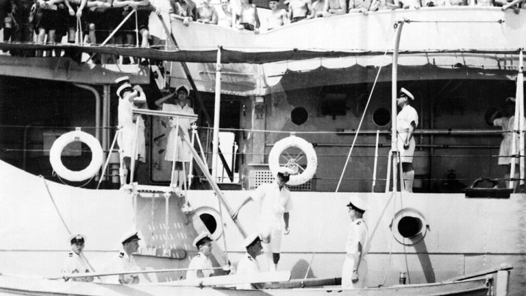 Prince Philip (in sunglasses) relinquishes control of HMS Magpie in Malta in July 1951. Pic: AP