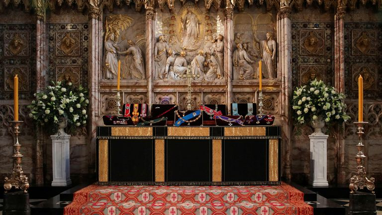 Insignia belonging to Britain's Prince Philip are placed on the altar in St George's Chapel, Windsor, ahead of his funeral, Britain April 16, 2021. Picture taken April 16, 2021. Steve Parsons/Pool via REUTERS