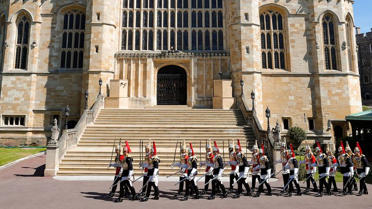 Members of Household Cavalry march by St George's Chapel. Pic: AP