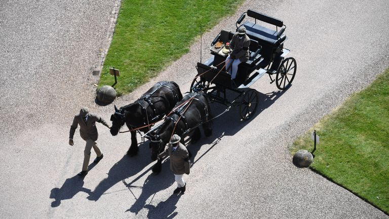 Fell ponies, Balmoral Nevis and Notlaw Storm pullling the Duke of Edinburgh's driving carriage arrive for the funeral of the Duke in Windsor Castle, Berkshire. Picture date: Saturday April 17, 2021.