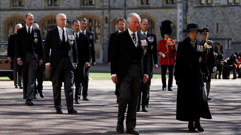 Britain's Prince Charles walks behind the hearse on the grounds of Windsor Castle during the funeral of Britain's Prince Philip, husband of Queen Elizabeth, who died at the age of 99, in Windsor, Britain, April 17, 2021. Alastair Grant/Pool via REUTERS