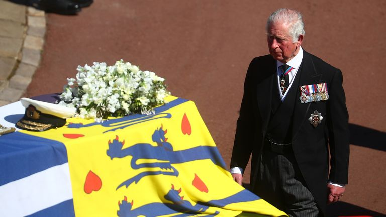 The Prince of Wales walks behind The Duke of Edinburgh's coffin, covered with His Royal Highness's Personal Standard, outside St George's Chapel, Windsor Castle, Berkshire, before the funeral of the Duke of Edinburgh. Picture date: Saturday April 17, 2021.