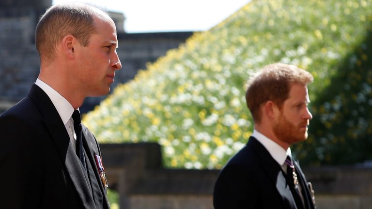Britain's Prince William, Duke of Cambridge and Prince Harry, Duke of Sussex walk behind the hearse on the grounds of Windsor Castle during the funeral of Britain's Prince Philip, husband of Queen Elizabeth, who died at the age of 99, in Windsor, Britain, April 17, 2021. Alastair Grant/Pool via REUTERS