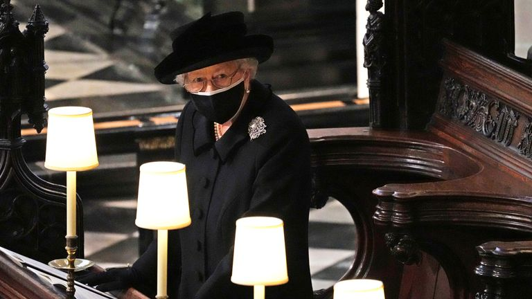 The Queen caught alone in St George's Chapel