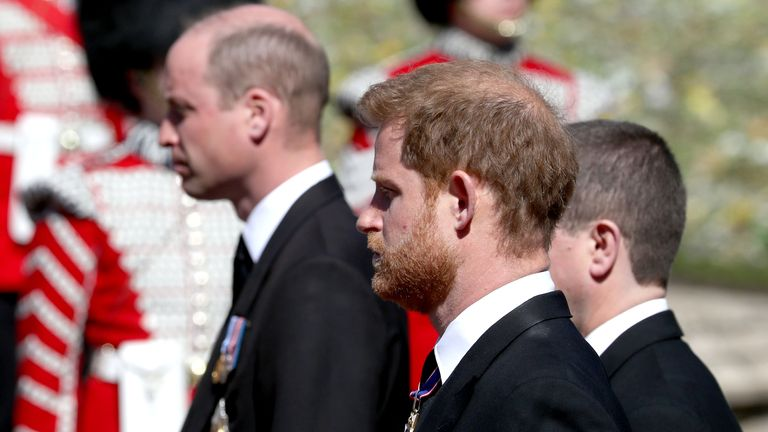 The Duke of Cambridge (left) and the Duke of Sussex (centre) follow the coffin of their grandfather, the Duke of Edinburgh, as it passes through the Parade Ground, during his funeral at Windsor Castle, Berkshire. Picture date: Saturday April 17, 2021.