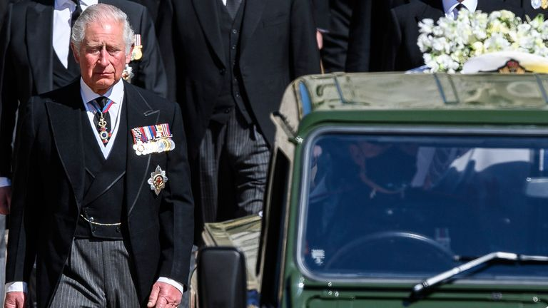Prince Charles follows the coffin as it makes it's way past the Round Tower. Pic: AP