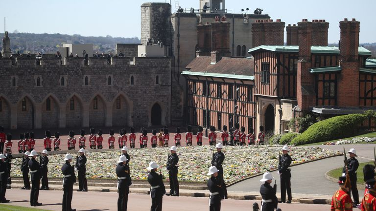 Members of the Royal Marines and the Foot Guards line the route of the procession