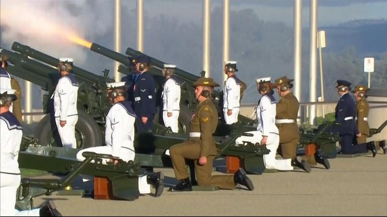 The Australian Federation Guard fire a 41-gun salute from outside the country's Parliament House as a tribute to Prince Philip.